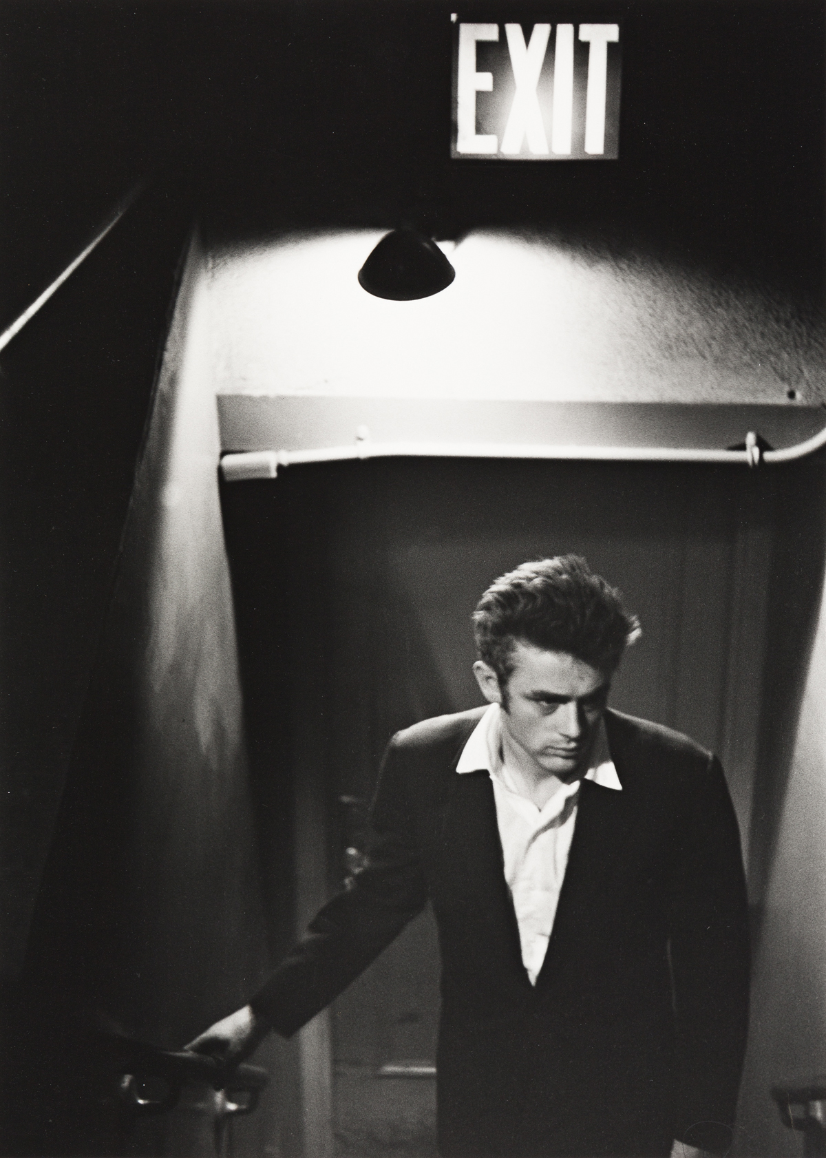ROY-SCHATT-(1909-2002)-James-Dean-underneath-an-exit-sign
