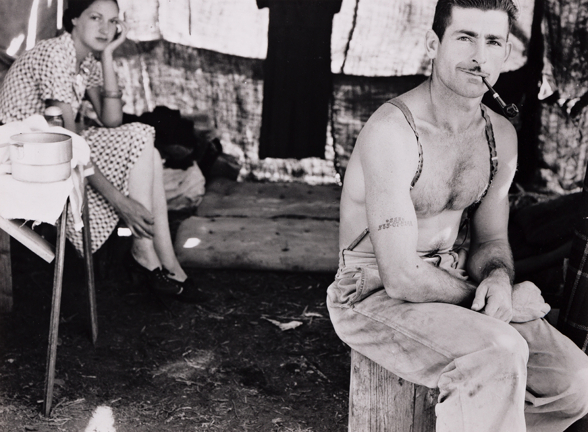 (DOROTHEA LANGE) (1895-1965) Unemployed lumber worker goes with his wife to the bean harvest, Oregon.