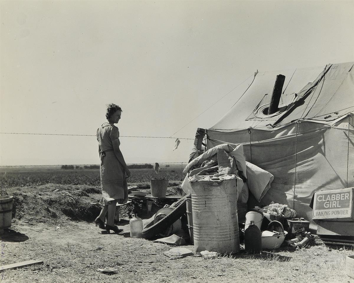 DOROTHEA LANGE (1895-1965) Mother of two small children from Arkansas camped along the ditchback 9 miles from Calipatria, California, I