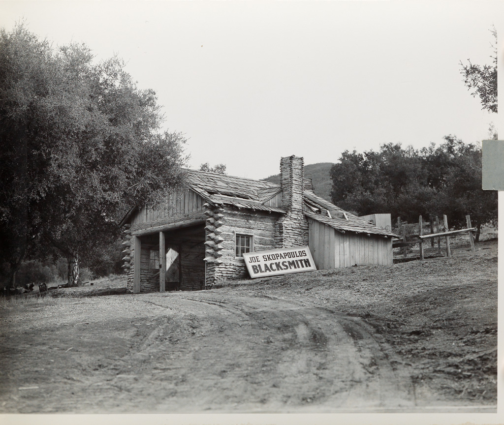 (WARNER BROTHERS SET RANCH) Thick album with 86 photographs of convincing movie sets on the Warner Bros. Ranch backlot during the Golde