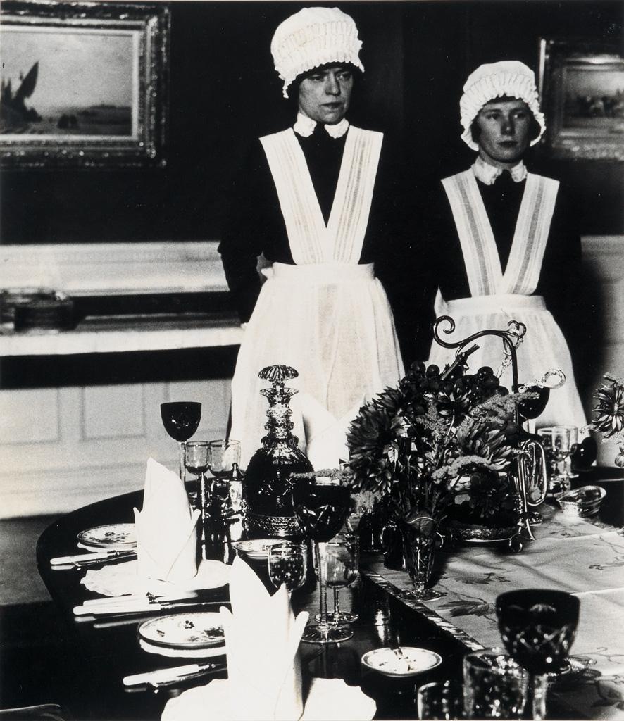 BILL BRANDT (1904-1983) Parlourmaid and Under-Parlourmaid Ready to Serve Dinner.