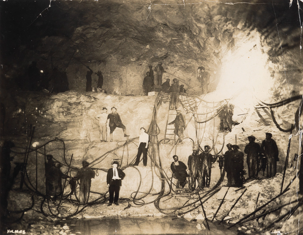 (INDUSTRIAL DISASTER--HAWKS NEST TUNNEL CONSTRUCTION) A pair of albums with 100 photographs documenting construction of the infamous tu