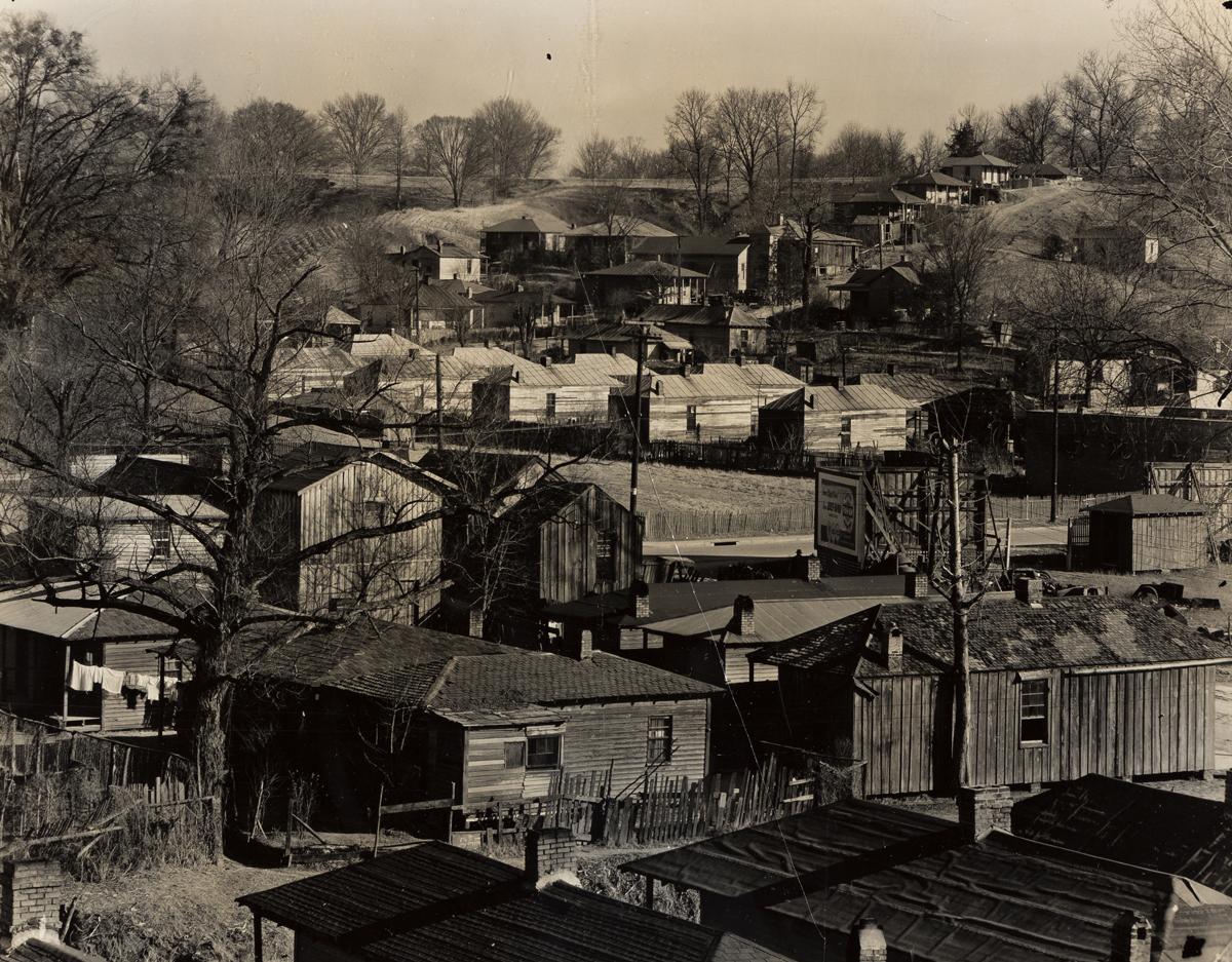 WALKER EVANS (1903-1975) Houses in the Negro Quarter, Vicksburg, Mississippi.