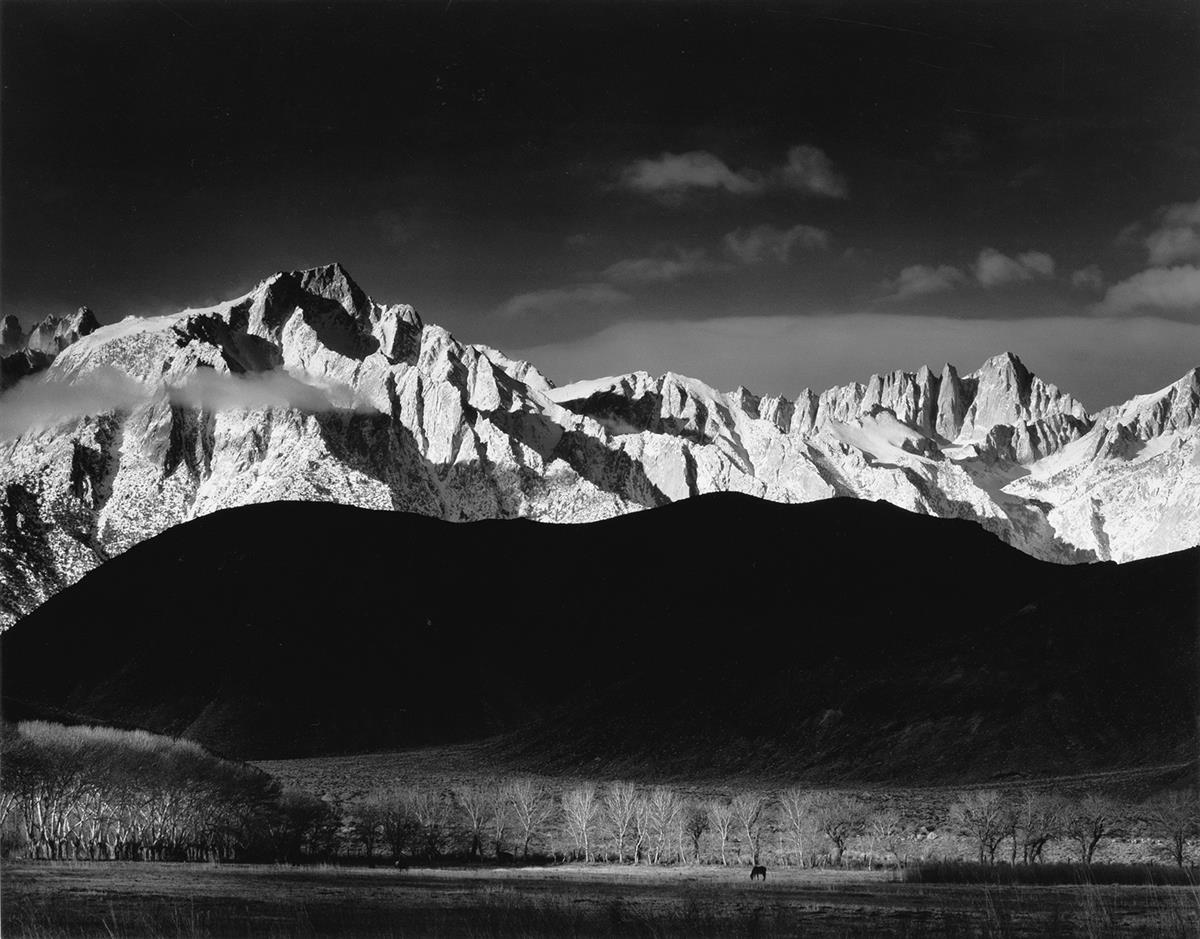 ANSEL ADAMS (1902-1984) Winter Sunrise, Sierra Nevada from Lone Pine, California.