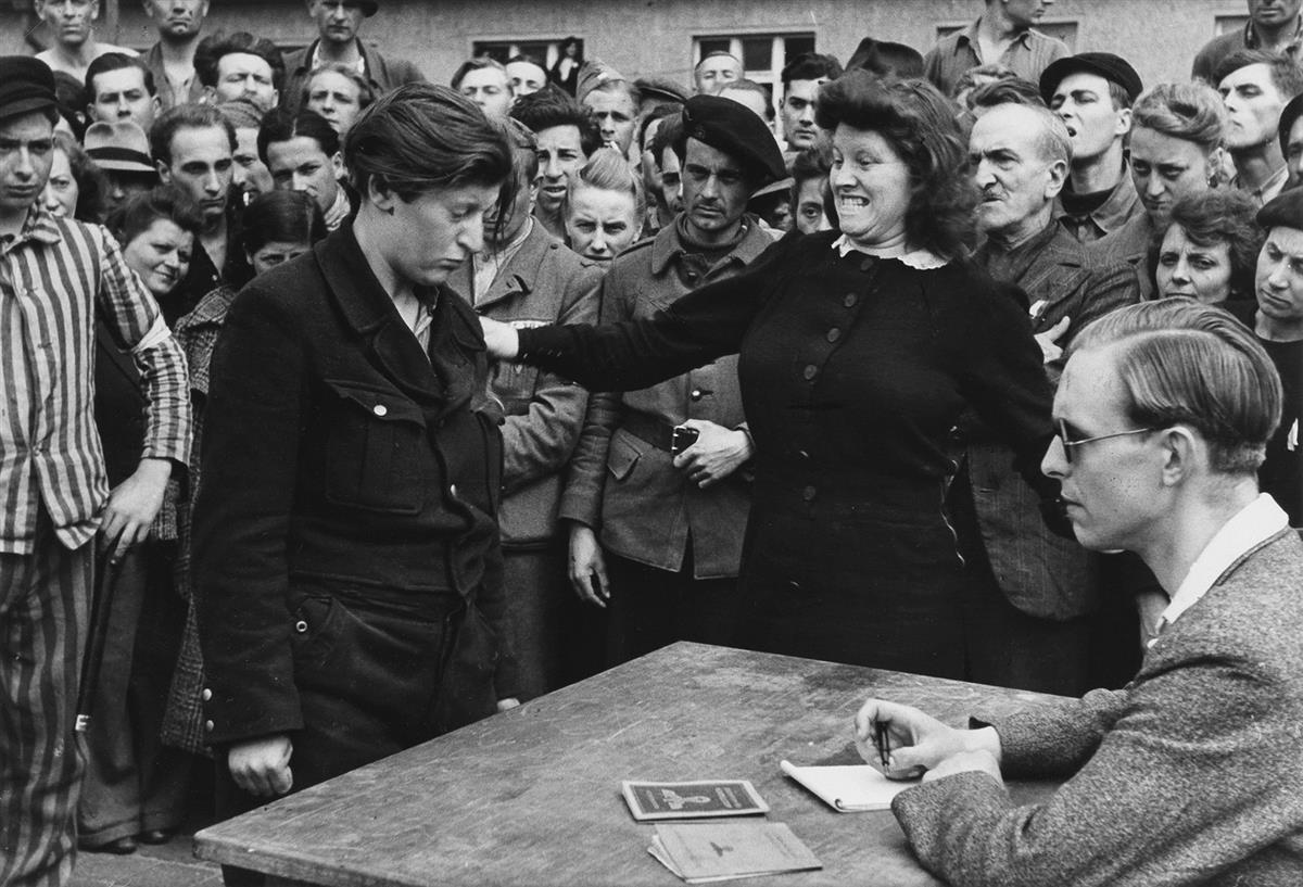 HENRI CARTIER-BRESSON (1908-2004) Gestapo informer recognized by a woman she had denounced, Dessau, Germany.