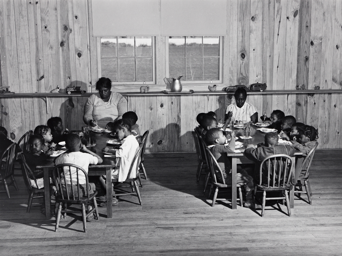 MARION POST WOLCOTT (1910-1990) Hot lunches for children of agricultural workers in day nursery of Okeechobee Migratory Labor Camp, Bel