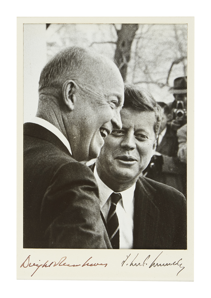 KENNEDY, JOHN F.; AND DWIGHT D. EISENHOWER. Photograph Signed, by both, bust portrait by Elliott Erwitt, showing Eisenhower laughing wh