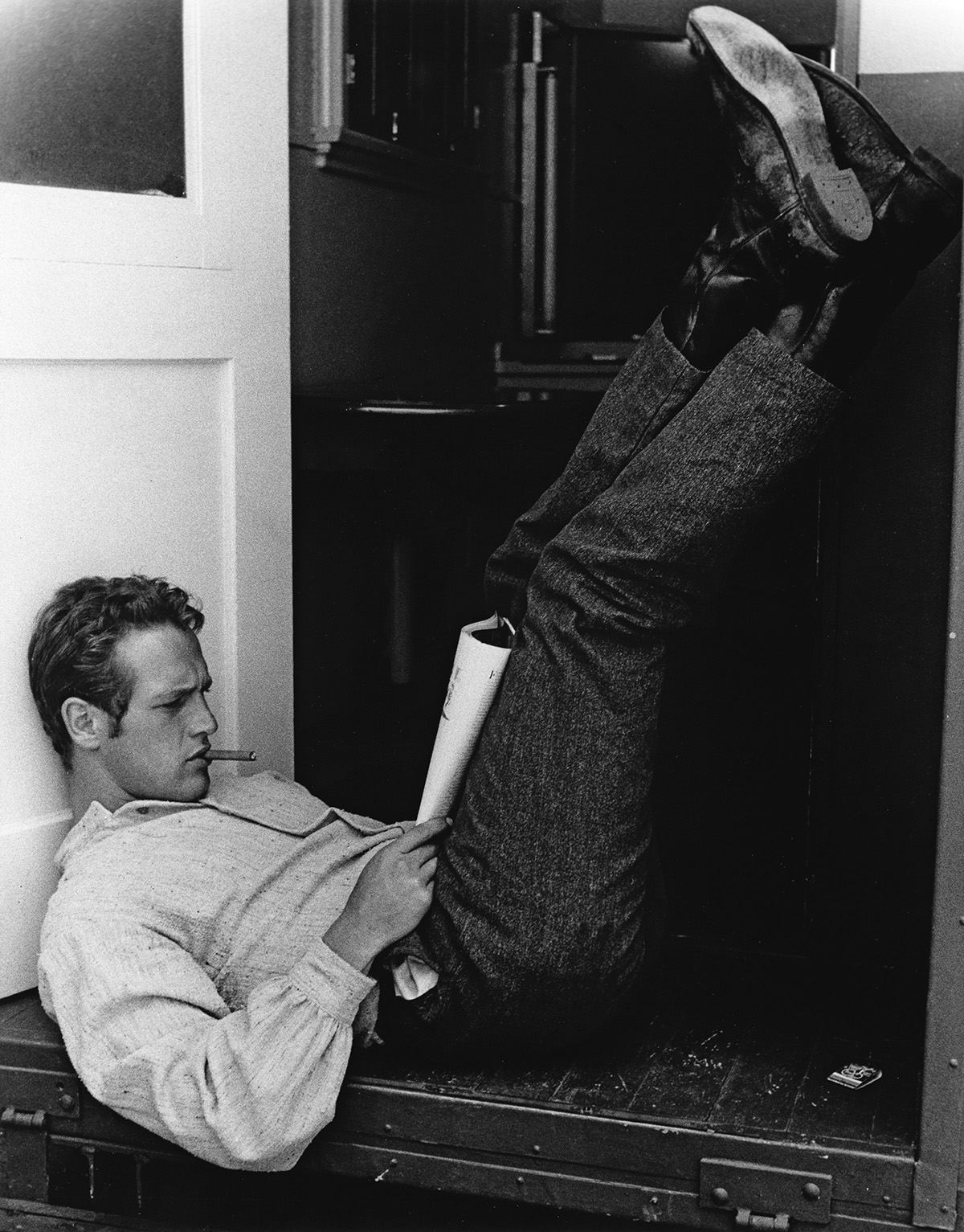 JOHN R. HAMILTON (1923-1997) Paul Newman, outside the door of his dressing room at Warner Bros. Studio, on a break from filming The Lef