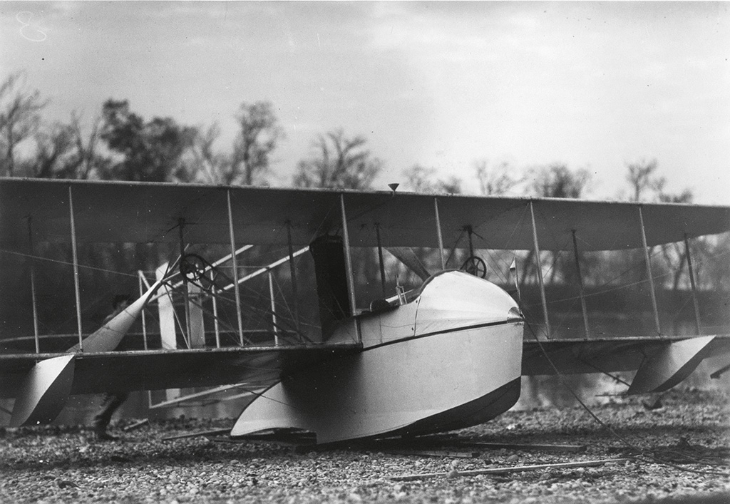 (WRIGHT BROTHERS--HYDROPLANE) Group of 8 photographs depicting the Wright Bros. hydroplane, including views of the airship in flight