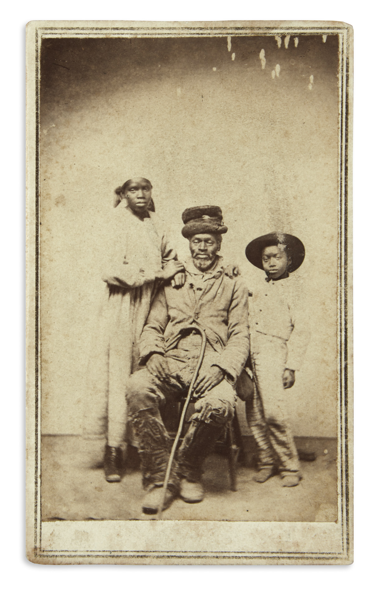 (MILITARY--CIVIL WAR.) Newell, Lafayette V.; photographer. Photograph of a contraband family at Point Lookout.