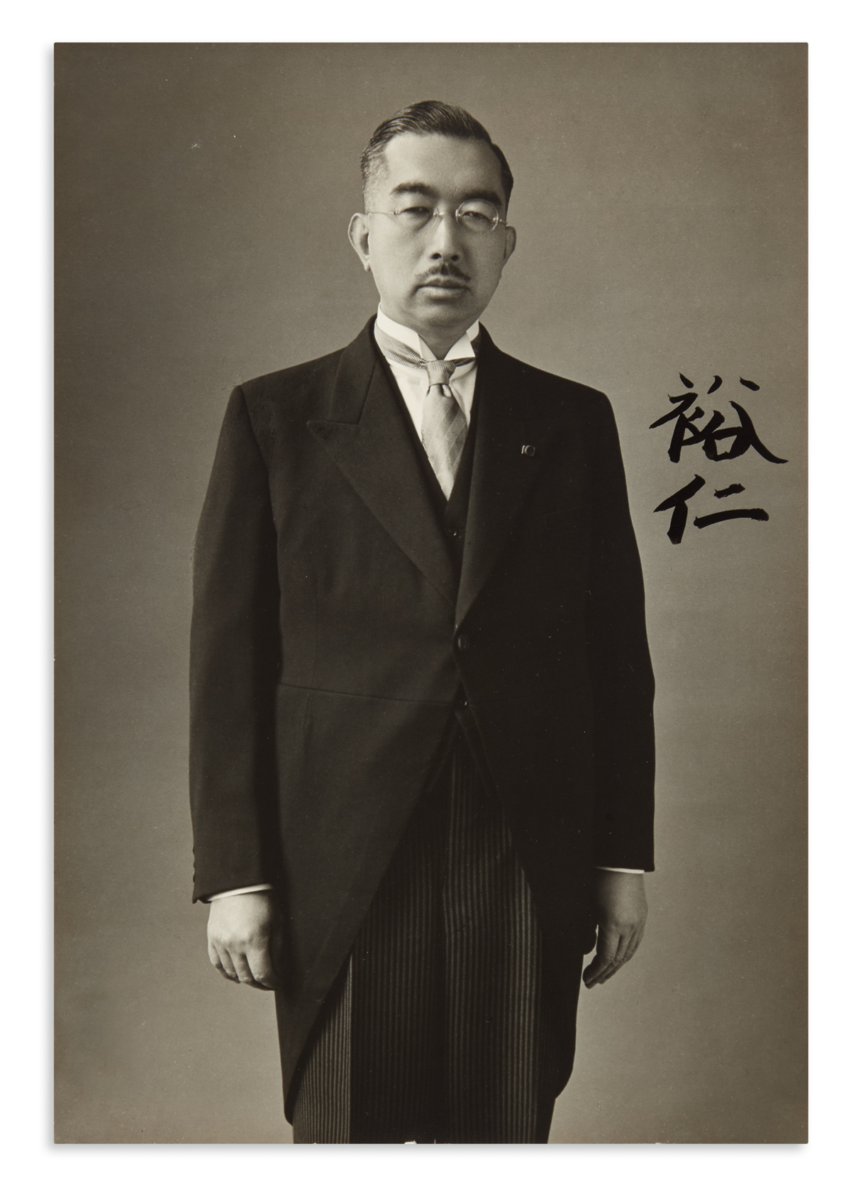 HIROHITO AND NAGAKO; EMPEROR AND EMPRESS OF JAPAN. Two Photographs Signed, each by one, in Japanese,