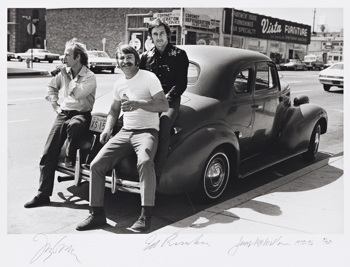 JERRY MCMILLAN (1936- ) Joe Goode, Ed Ruscha and Jerry McMillan (self-portrait) with Eds 39 Chevy.