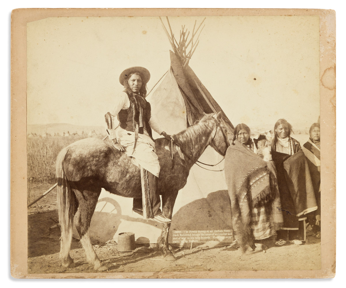 (AMERICAN INDIANS--PHOTOGRAPHS.) John C. Grabill, photographer. A Pretty Group at an Indian Tent.