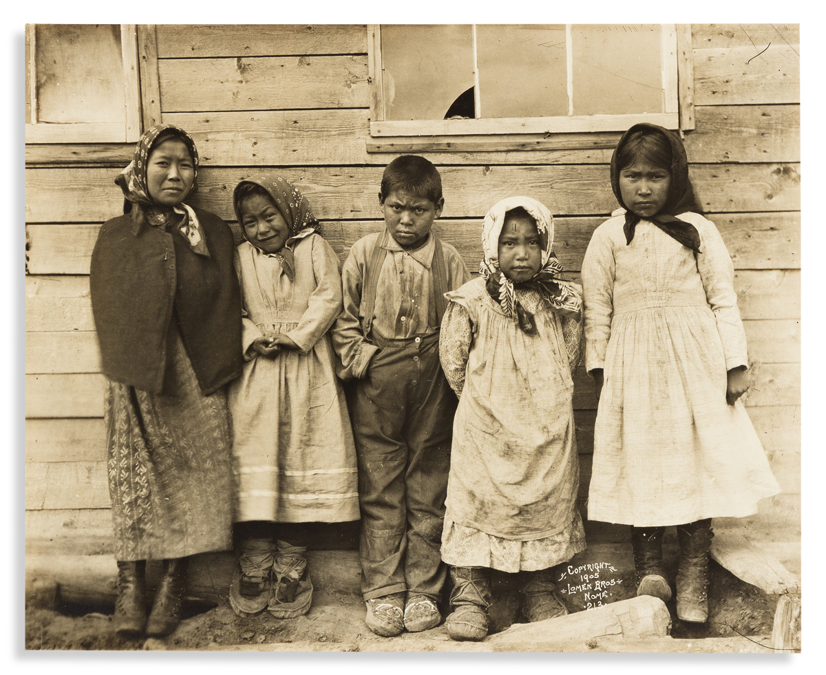 (ALASKA.) Lomen Brothers, photographers. Photograph of 5 Inuit children in Nome.