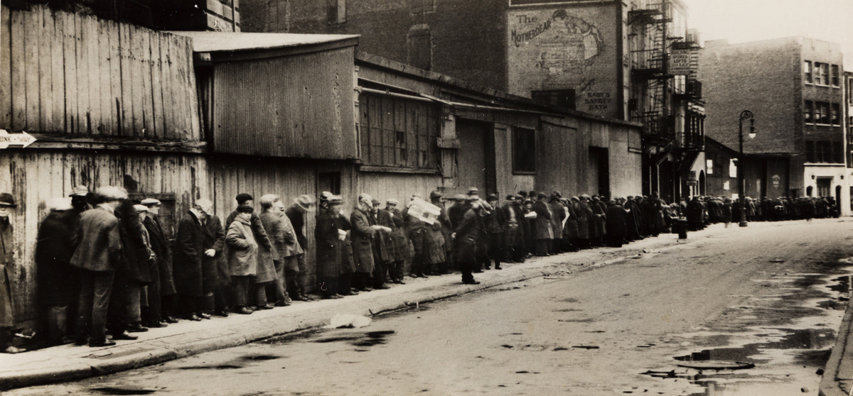 EWING GALLOWAY AGENCY (1920s-1950s) Breadline at McCauley Water Street, Mission under Brooklyn Bridge.