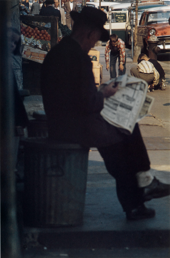 SAUL LEITER (1923-2013) Man Reading Outdated Newspaper, 1st Avenue and 9th.