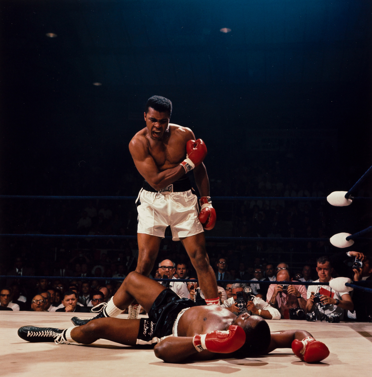 NEIL LEIFER (1942- ) Muhammad Ali reacts after his first round knockout of Sonny Liston during the 1965 World Heavyweight Title fight