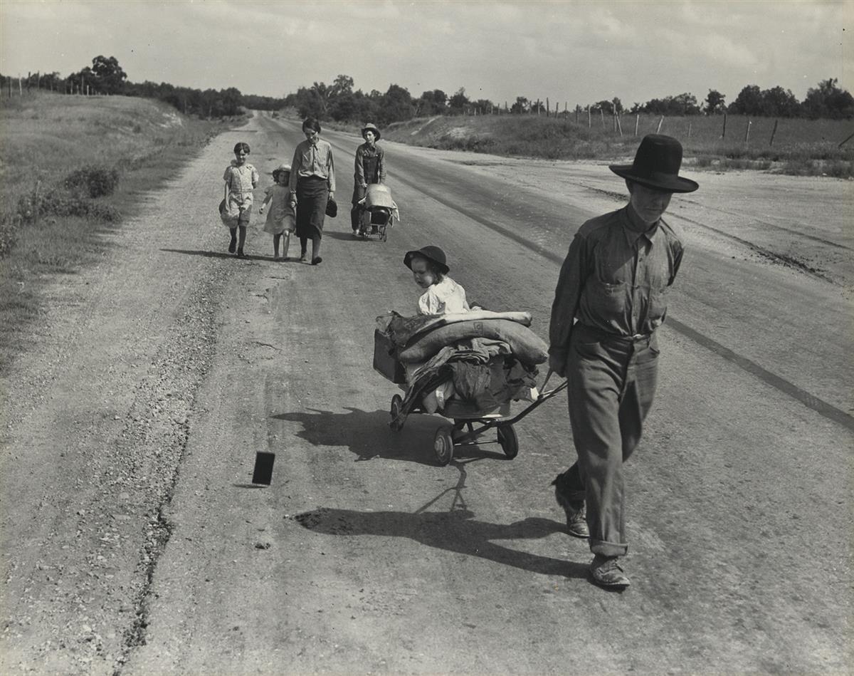 DOROTHEA LANGE (1895-1965) Family walking on highway, five children.