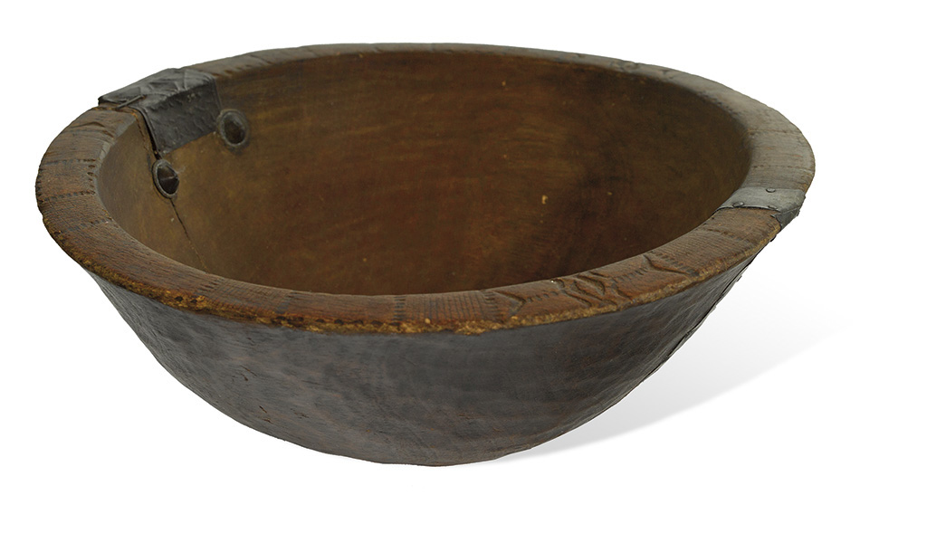 """SLAVE CULTURE. Antique American burl bowl, incised with African """"Adinka"""" designs along the lip."""