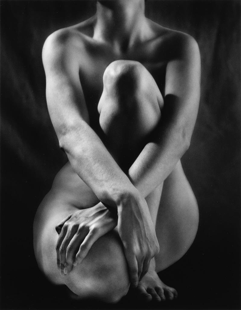 RUTH BERNHARD (1905-2006) Classic Torso with Hands.