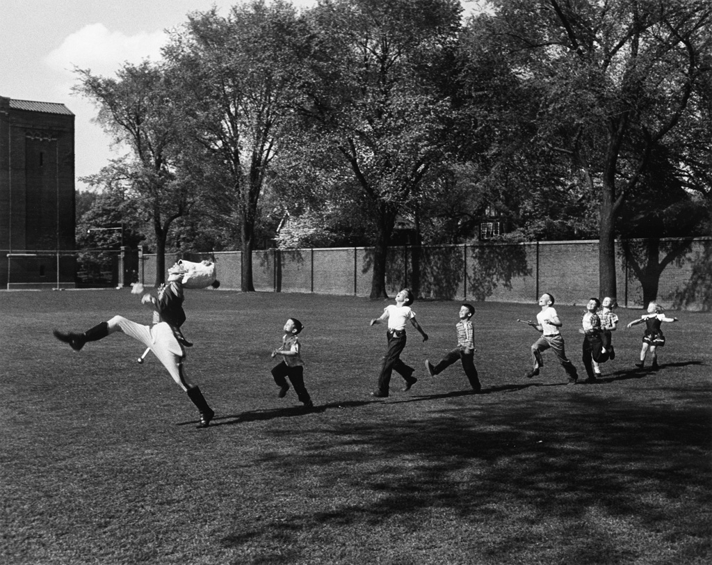 ALFRED EISENSTAEDT (1898-1995) Drum major for the University of Michigan marching band, practicing his high-kicking prance, leads line