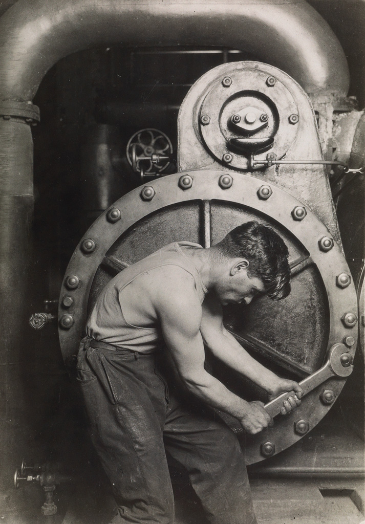 LEWIS-W-HINE-(1874-1940)-Mechanic-at-Steam-Pump-in-Electric-