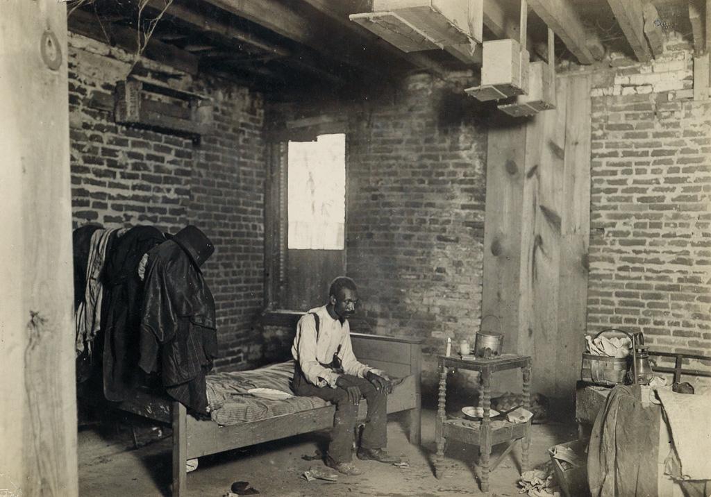 LEWIS W. HINE (1874-1940) Consumptive, living quarters below sidewalk, Washington, D.C.