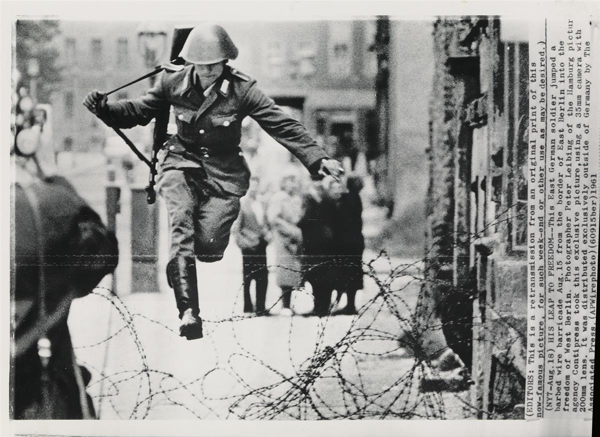 PETER-LEIBING-(1941-2008)-Leap-into-Freedom-[East-German-soldier-Hans-Conrad-Schumann-jumping-barbed-wire-barricade-to-freedom-as-he-de