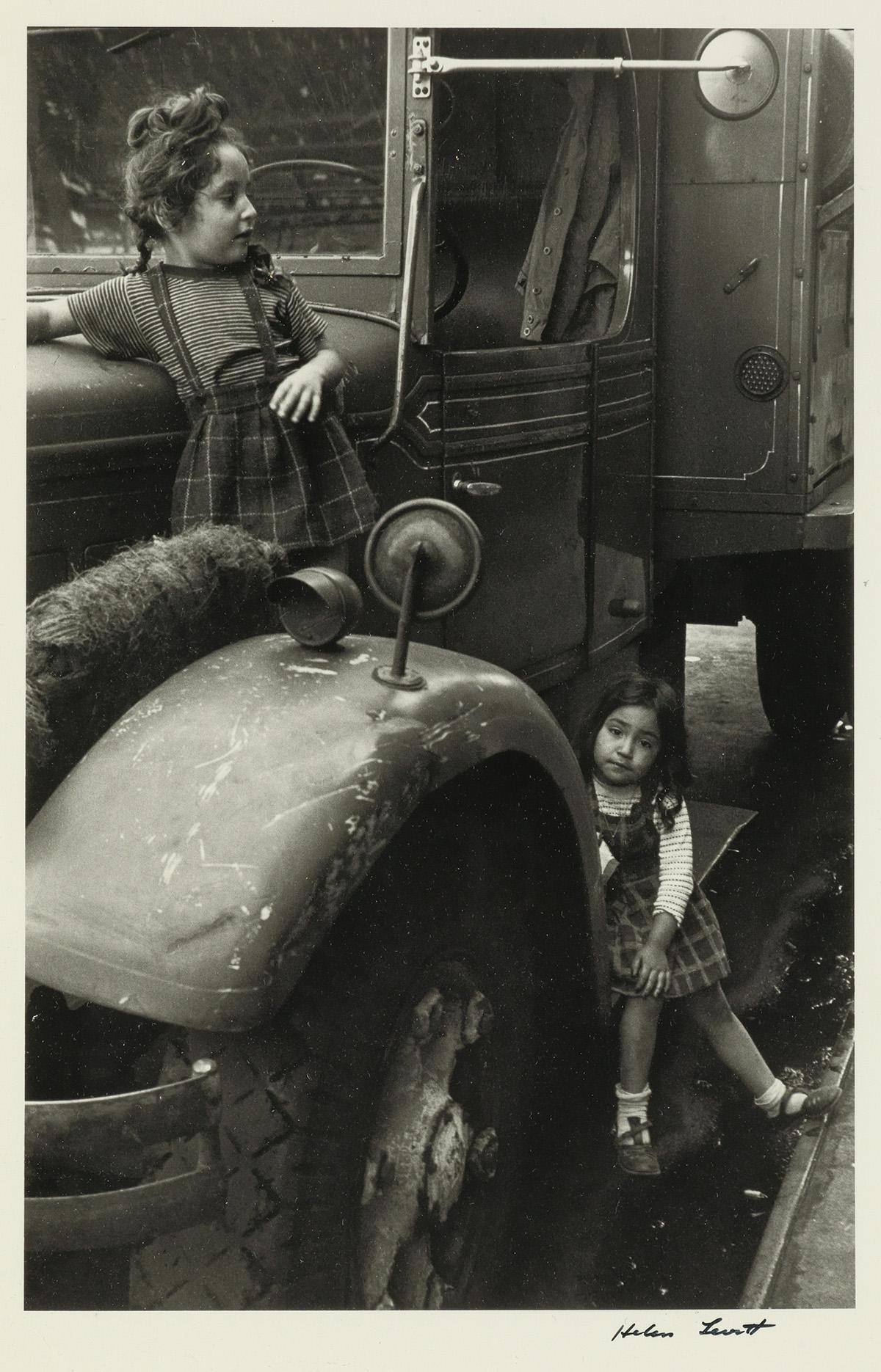 HELEN LEVITT (1913-2009) N.Y. (two girls on a truck).