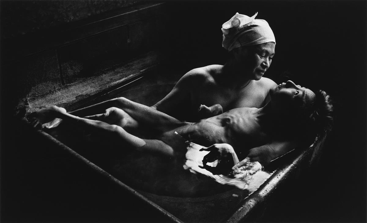 W. EUGENE SMITH (1918-1978) Tomoko Uemura in her Bath.