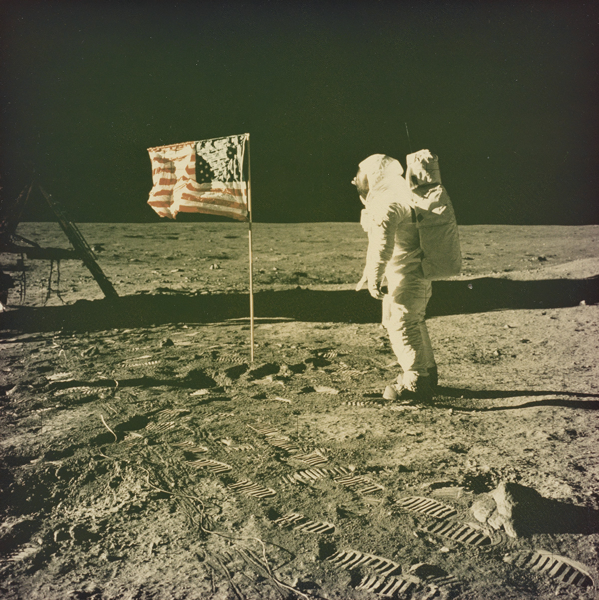 (APOLLO 11 MOON LANDING) Presentation album with 20 iconic photographs depicting the Apollo 11 Mission, featuring breathtaking views of