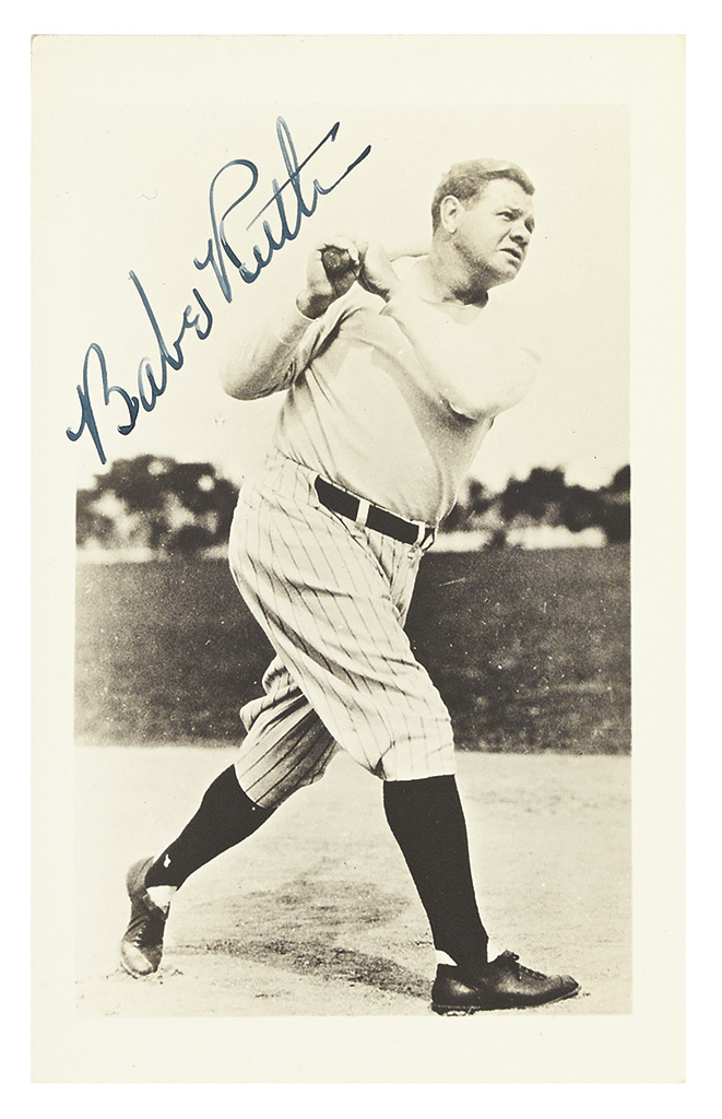 RUTH, BABE. Photograph Signed, full-length portrait showing him in uniform after swinging his bat.