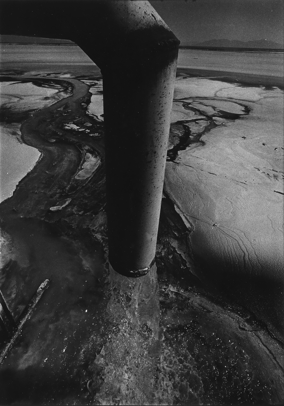 W-EUGENE-SMITH-(1918-1978)-Chisso-Factory-conduit-pipe-Minam