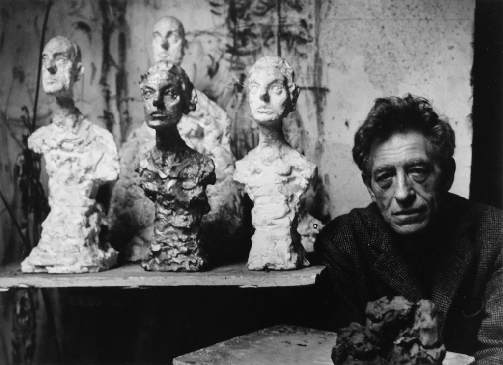 BRASSAÏ (1899-1984) Alberto Giacometti in his studio.