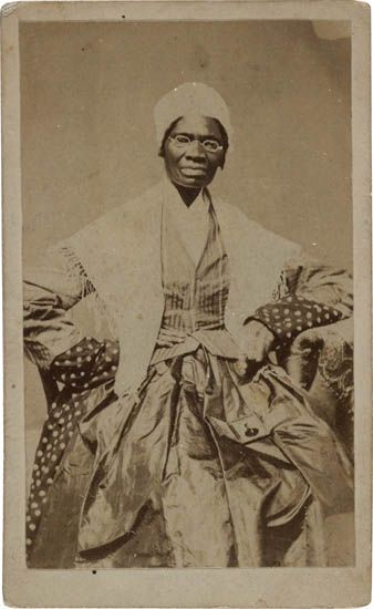 (SLAVERY AND ABOLITION.) TRUTH, SOJOURNER. Carte-de-visite, showing the subject seated with a daguerreotype on her lap.