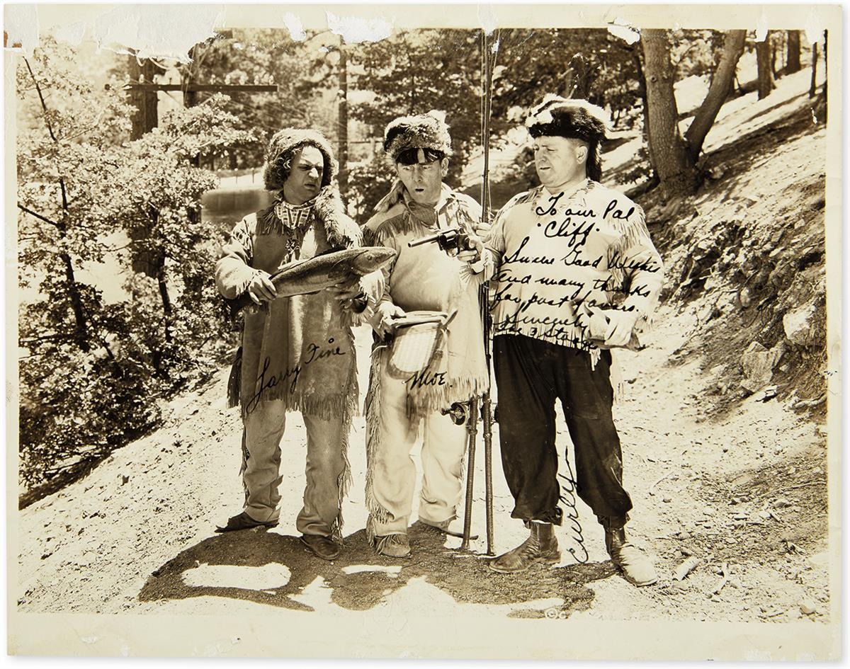 (THREE STOOGES, THE.) Photograph Signed, by each: Moe Howard (Moe), Jerry Howard (Curly), and Larry Fine (in full), and additionall