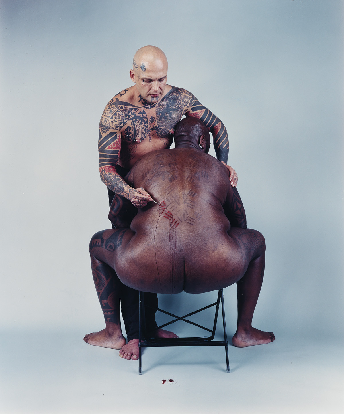 CATHERINE OPIE (1961- ) Ron Athey/Human Printing Press with Darryl Carlton, from Four Scenes.