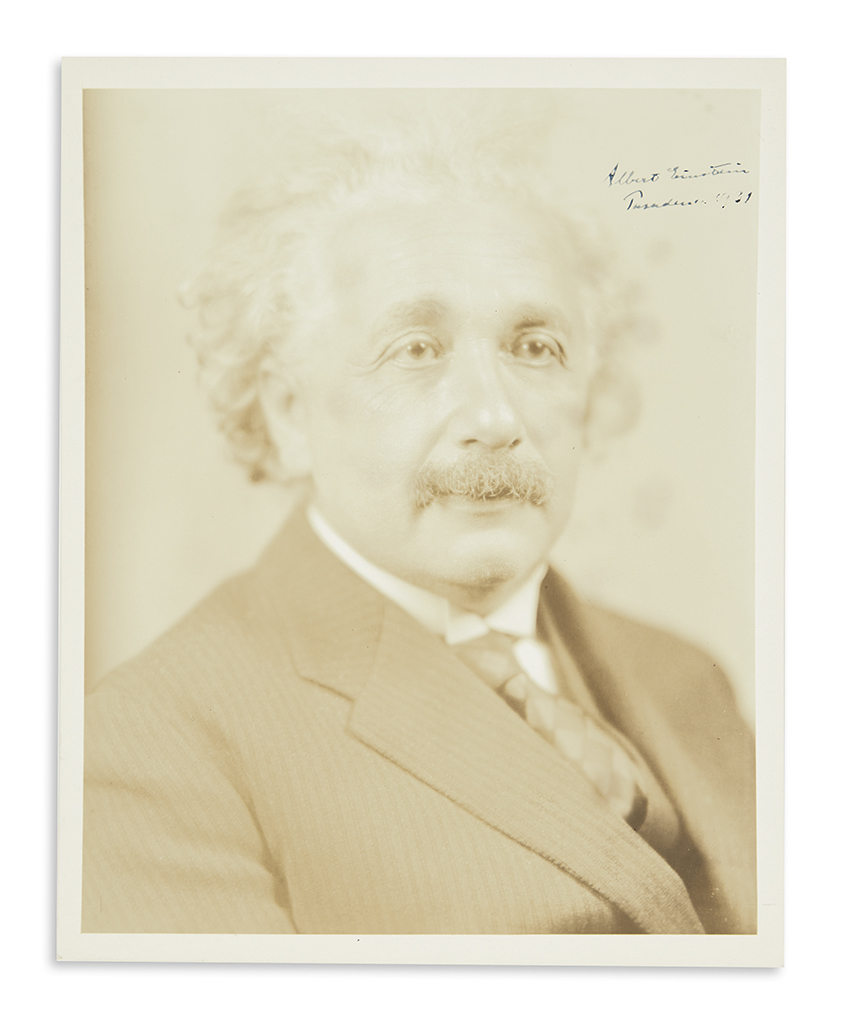 (SCIENTISTS.) EINSTEIN, ALBERT. Photograph dated and Signed, bust portrait showing him in ¾-view.