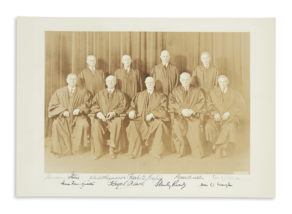 (SUPREME COURT.) Photograph Signed by all nine justices of the 1939 Hughes Court, group portrait by Harris & Ewing,