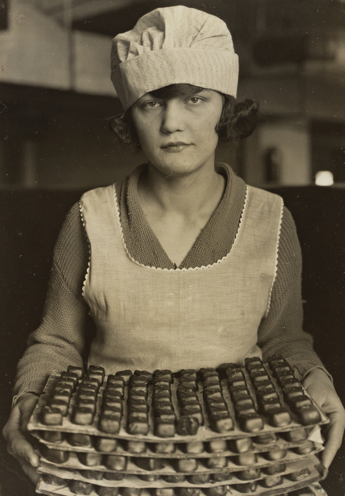 LEWIS W. HINE (1874-1940) Candy Maker, New York City.