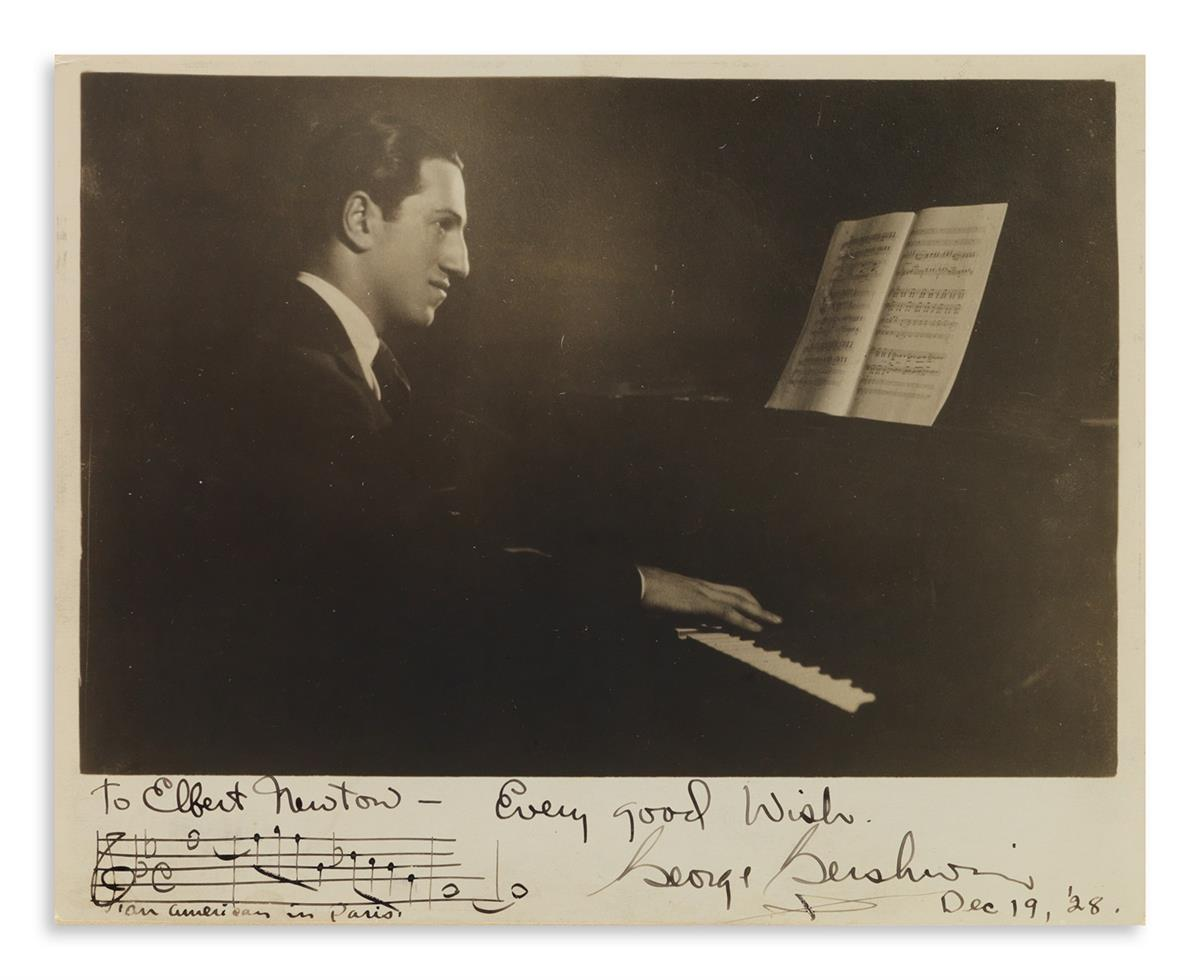 GERSHWIN, GEORGE. Photograph Signed and Inscribed, with an Autograph Musical Quotation from An American in Paris.