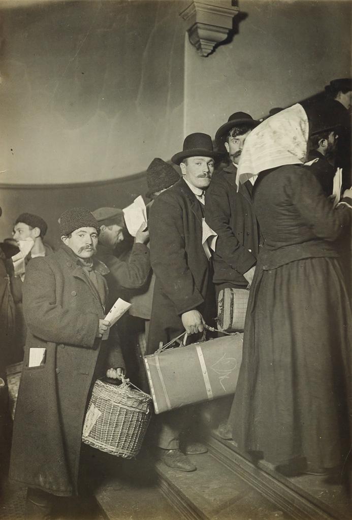 LEWIS W. HINE (1874-1940) Climbing into America (Ellis Island group).