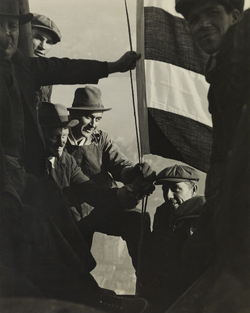 LEWIS W. HINE (1874-1940) Workers with American flag, Empire State Building.