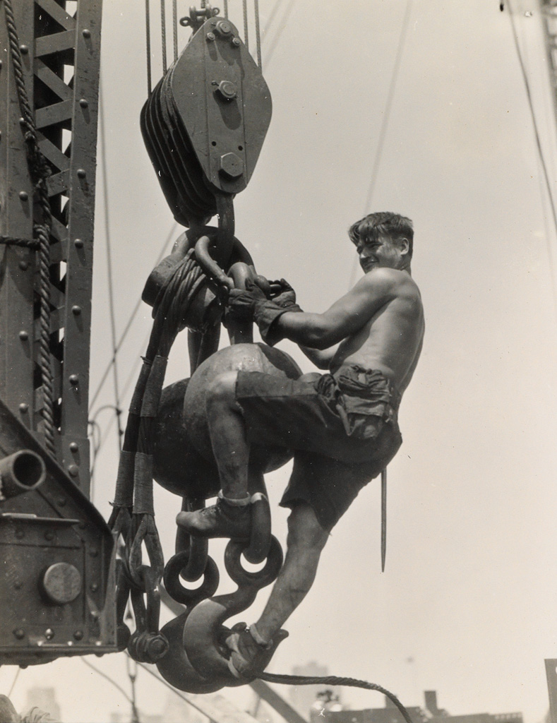 LEWIS-W-HINE-(1874-1940)-Laborer-on-connector-Empire-State-B