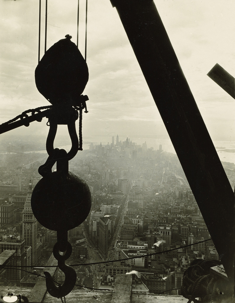 LEWIS-W-HINE-(1874-1940)-Silhouetted-crane-hook-(with-lower-