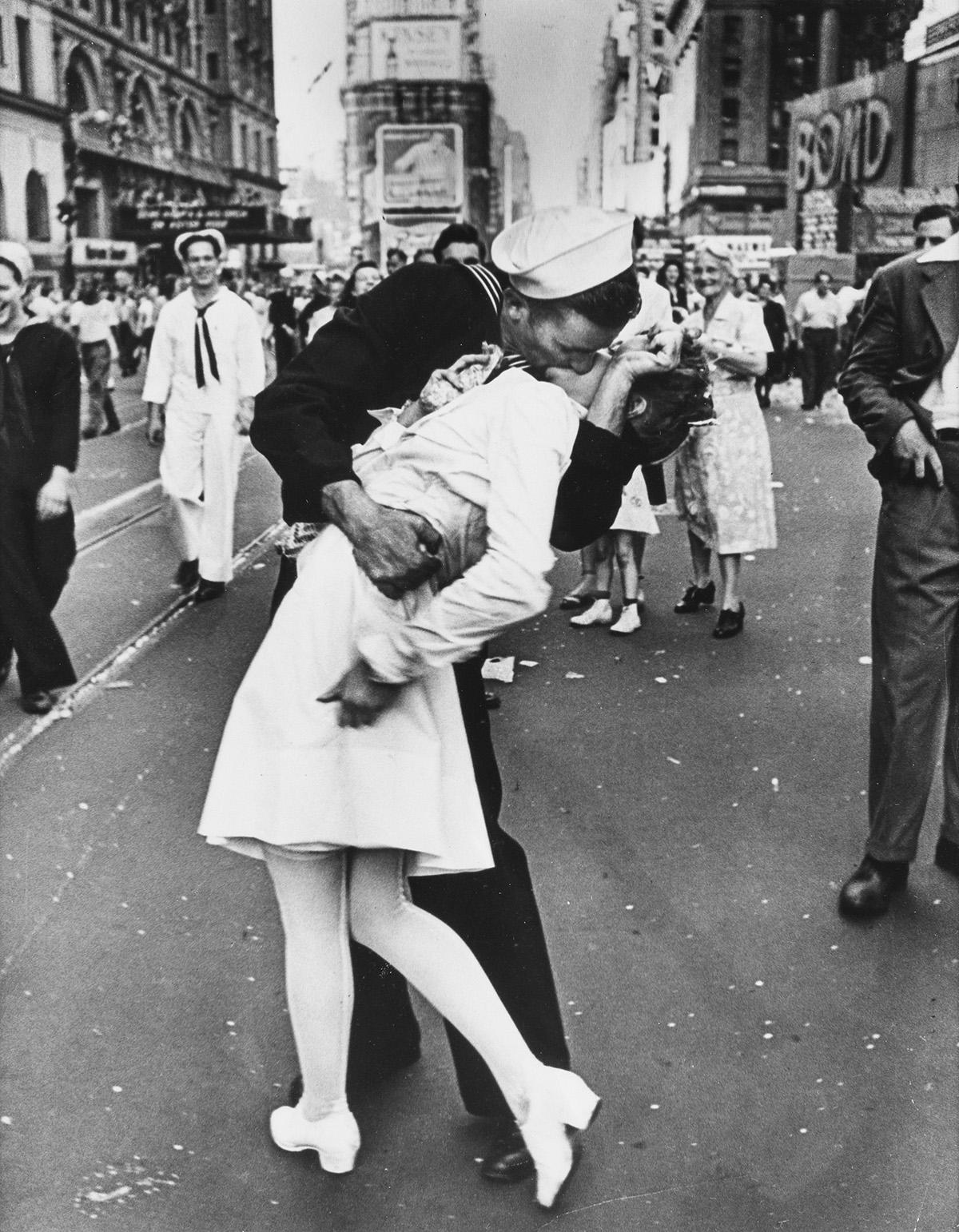 ALFRED EISENSTAEDT (1898-1995) V-J Day Kiss, Times Square, New York.