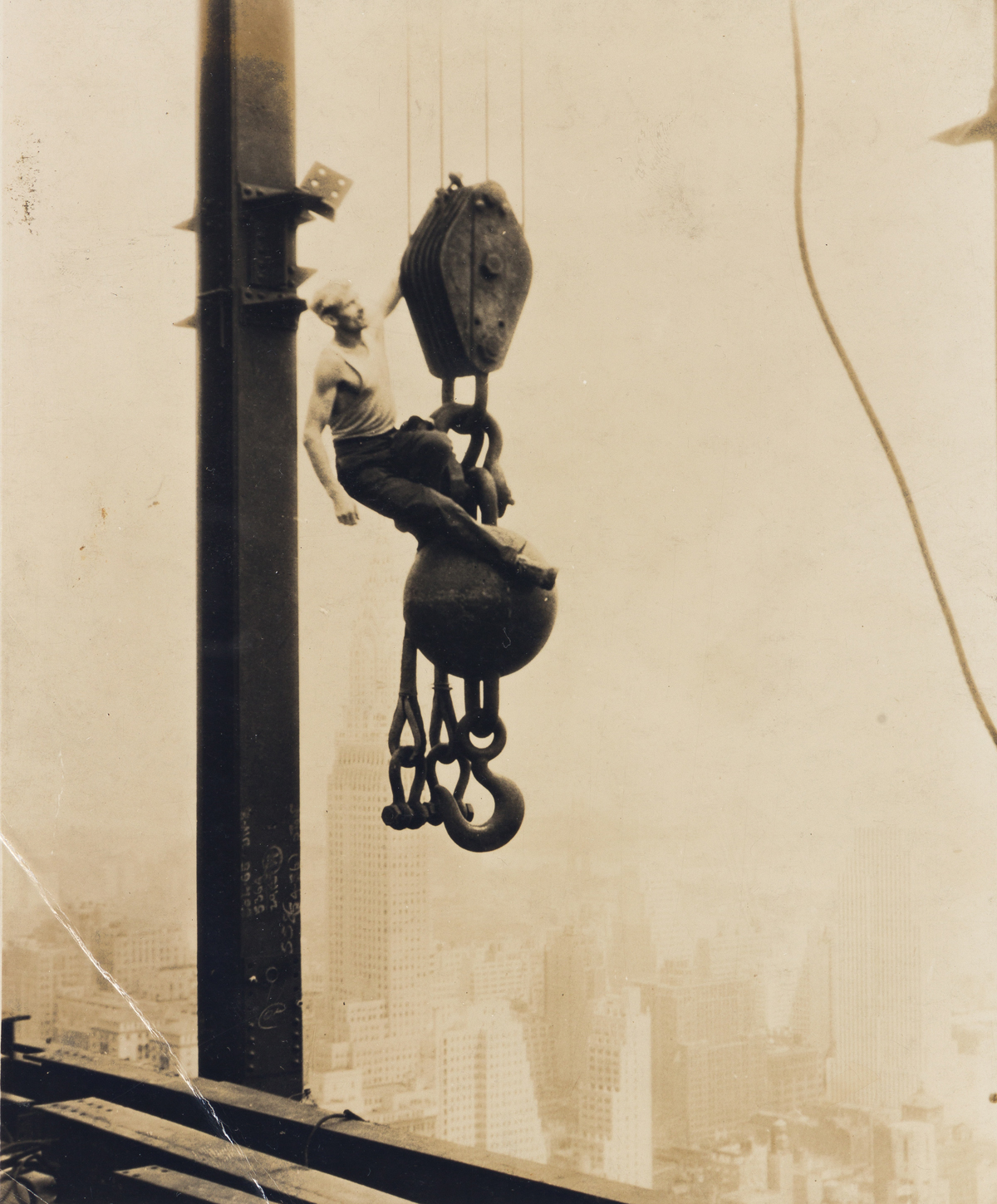 LEWIS W. HINE (1874-1940) One thousand feet above the sidewalks of New York.