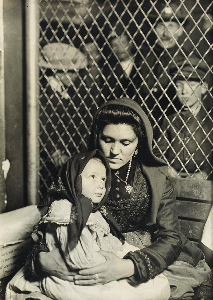 LEWIS W. HINE (1874-1940) Mother and child, Ellis Island [Italian Madonna].