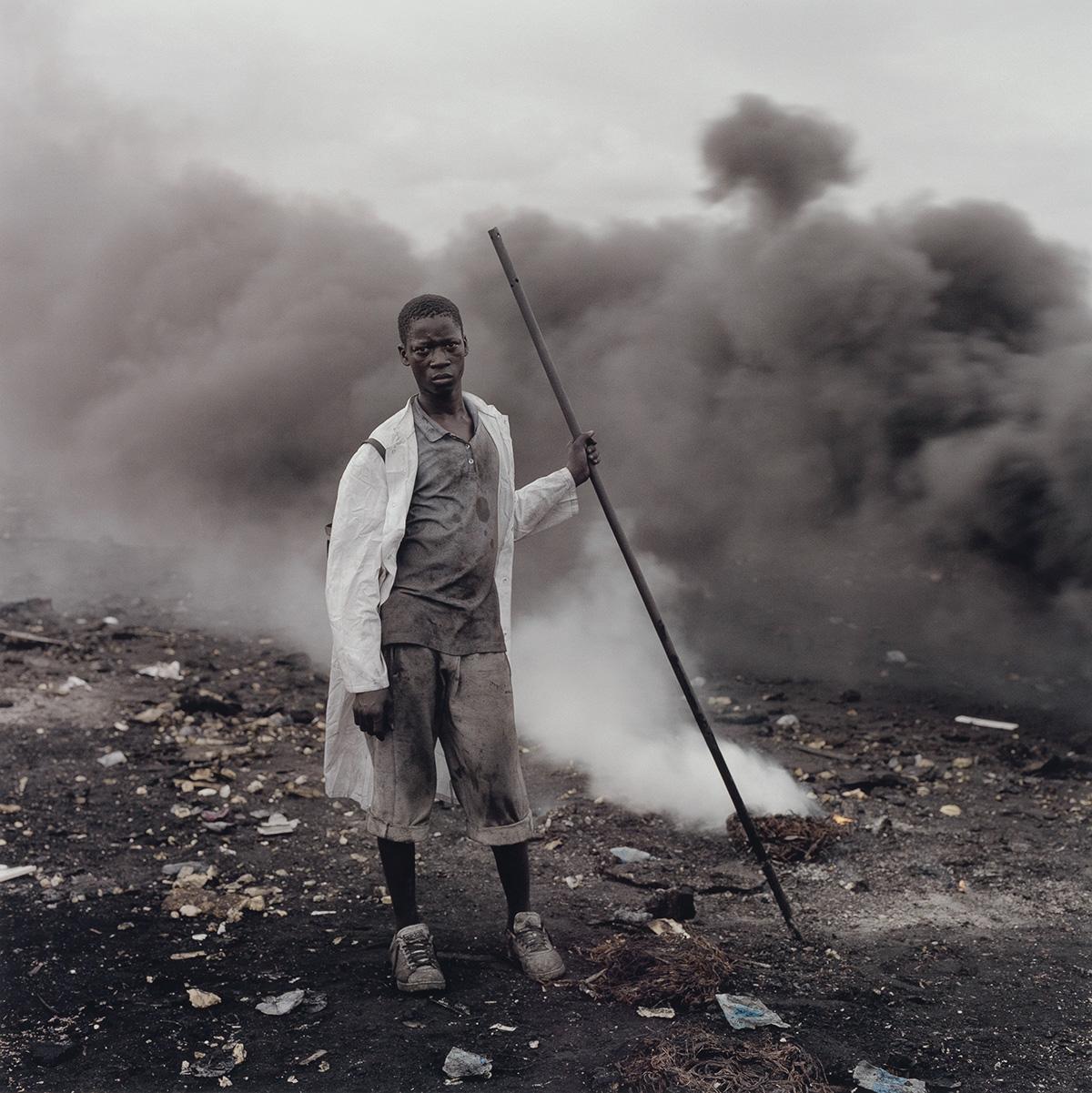 PIETER HUGO (1976- ) Abudulai Yahaya, Agbogbloshie Market, Accra, Ghana.