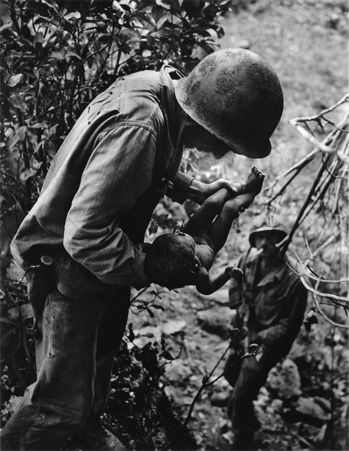 W-EUGENE-SMITH-(1918-1978)-Saipan-(Soldier-with-an-infant)